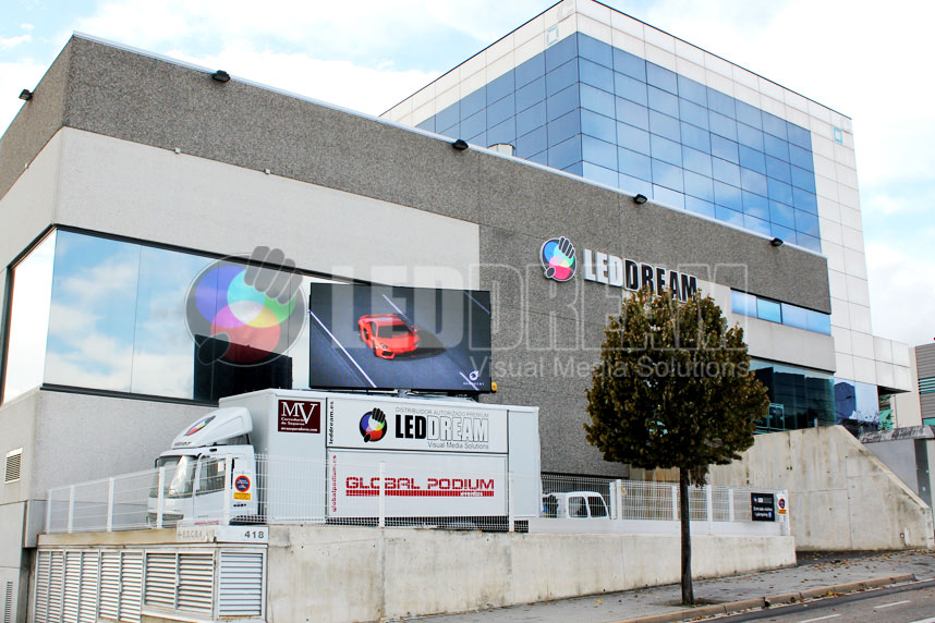 LED DREAM's headquarters in Barcelona, next to our rental podium van with giant LED screen
