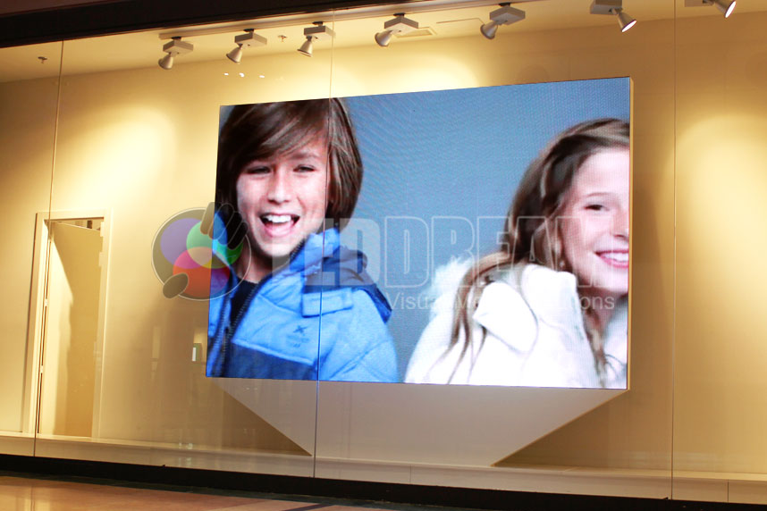 Indoor LED screen for retail shop of 3m x 2m (6mm of resolution). Piece of furniture used as support, unique design for the brand